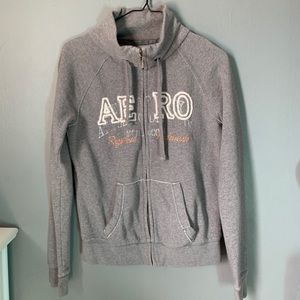 Grey sweater with lettering